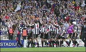 image: [ Grimsby players thank their fans after their golden goal win ]
