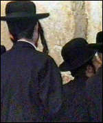 Jews in prayer at wailing wall