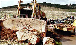 image: [ The breaking of ground at Har Homa has provoked a crisis in the peace process ]