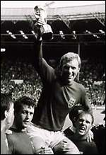 [ image: Bobby Moore with the trophy]