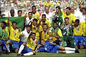 The Brazilian team celebrate with the World Cup