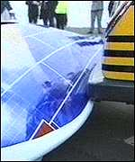 [ image: The solar car was left stuck under a taxi bumper]