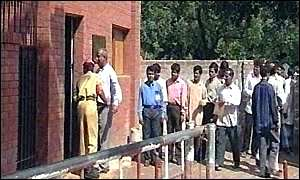 Bangladeshis queue for visas outside the Saudi Arabian embassy