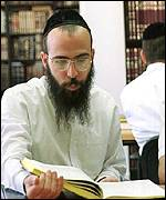Shas supporter studying scripture