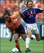 Davids and Dugarry in a tussle for the ball