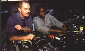 Dave de Mello (left) in his Zambian workshop
