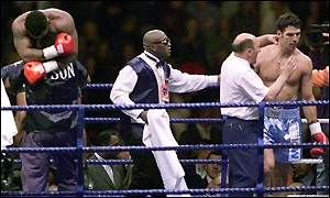 Tyson celebrates as Savarese is consoled by referee John Coyle