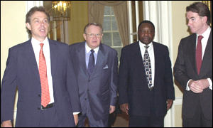 Arms inspectors Martti Ahtisaari and Cyril Ramaphosa presented their report to Tony Blair and Peter Mandelson