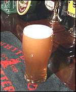 pint of beer on pub bar
