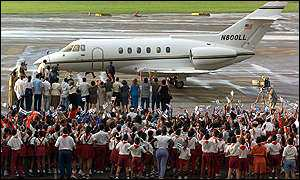 Crowds cheer as the plane carrying Elian touches down