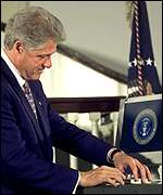 Clinton signs electronically, and with ink