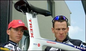 Lance Armstrong (right) and team-mate Tyler Hamilton