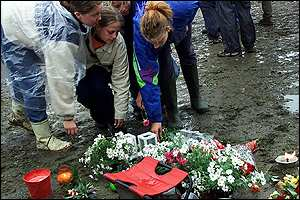 Festival-goers have need lighting candles and laying flowers in memory to the people killed