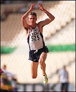 Jonathan Edwards jumps for gold