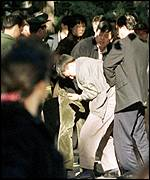 Police arresting Falun Gong members near Tiananmen Square
