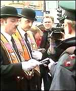 Orangemen hand a letter of protest to police