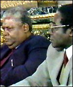 Joshua Nkomo (left) and Robert Mugabe