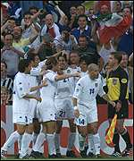 Italian players celebrate Delvecchio's goal