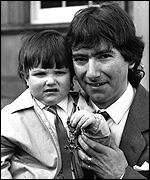 Receiving the MBE with his son Gary