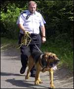 Policeman and dog