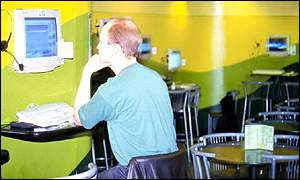 man in internet cafe