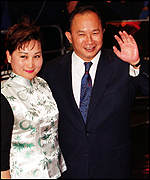 Film director John Woo and his wife