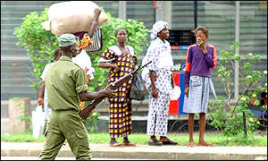 Soldier and civilians in Abidjan