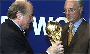 Franz Beckenbauer symbolically takes the World Cup