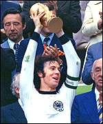 Beckenbauer lifts trophy