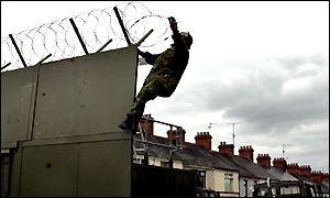 A soldier finishes a barrier in a nationalist area of Portadown