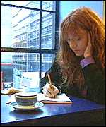 J.K. Rowling writing in cafe