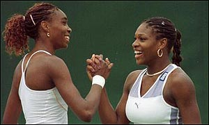 Venus and Serena celebrate doubles success