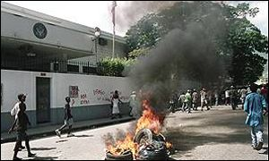 Tyres on fire outside the US embassy in Port-au-Prince
