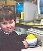 School pupil with a computer