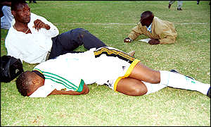 Players lie on the field