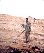 Ethiopian soldier with de-mining equipment