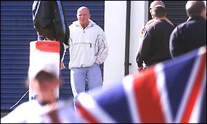 Johnny Adair watches the protest at Carlisle Circus