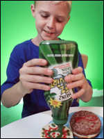 Child using green ketchup
