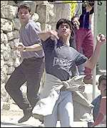 Palestinians throwing stones