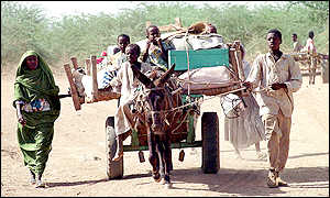 Refugees on donkey cart
