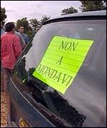 Protesters register their anger with Mondavi on a sign