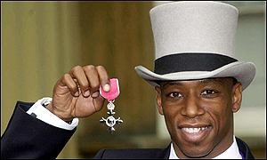 Ian Wright with his MBE medal