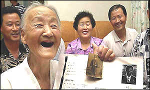 Lee Dock-man, 87, smiles after getting confirmation of the survival of her son Ahn Soon-hwan (65)