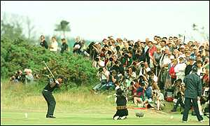 Tiger Woods produces a steady performance at the start of The Open