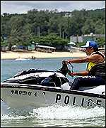 Police boat patrols the bay