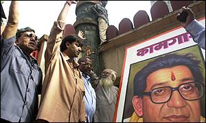 Shiv Sena men with a poster of Bal Thackeray