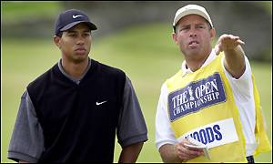 Tiger Woods and caddie