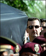 Bashar helping to carry his father's coffin
