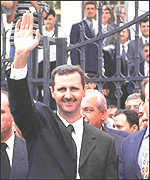 Bashar outside parliament after his swearing-in as president