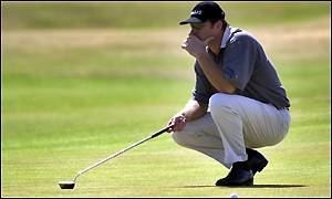 Nick Faldo contemplates a putt on the first green